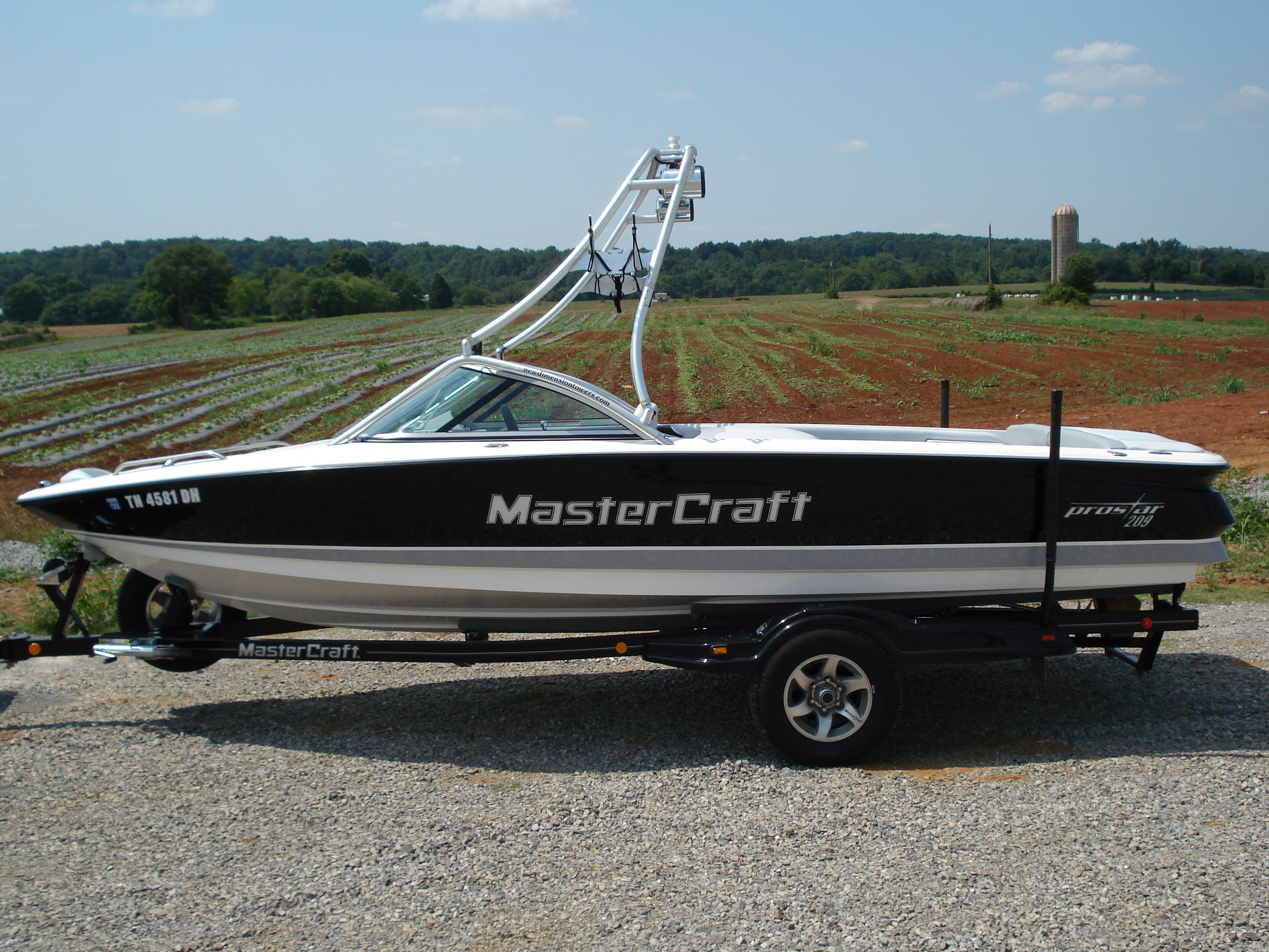 main view of 01 - 06 mastercraft prostar 209 wakeboard boat with new dimension wakeboard tower