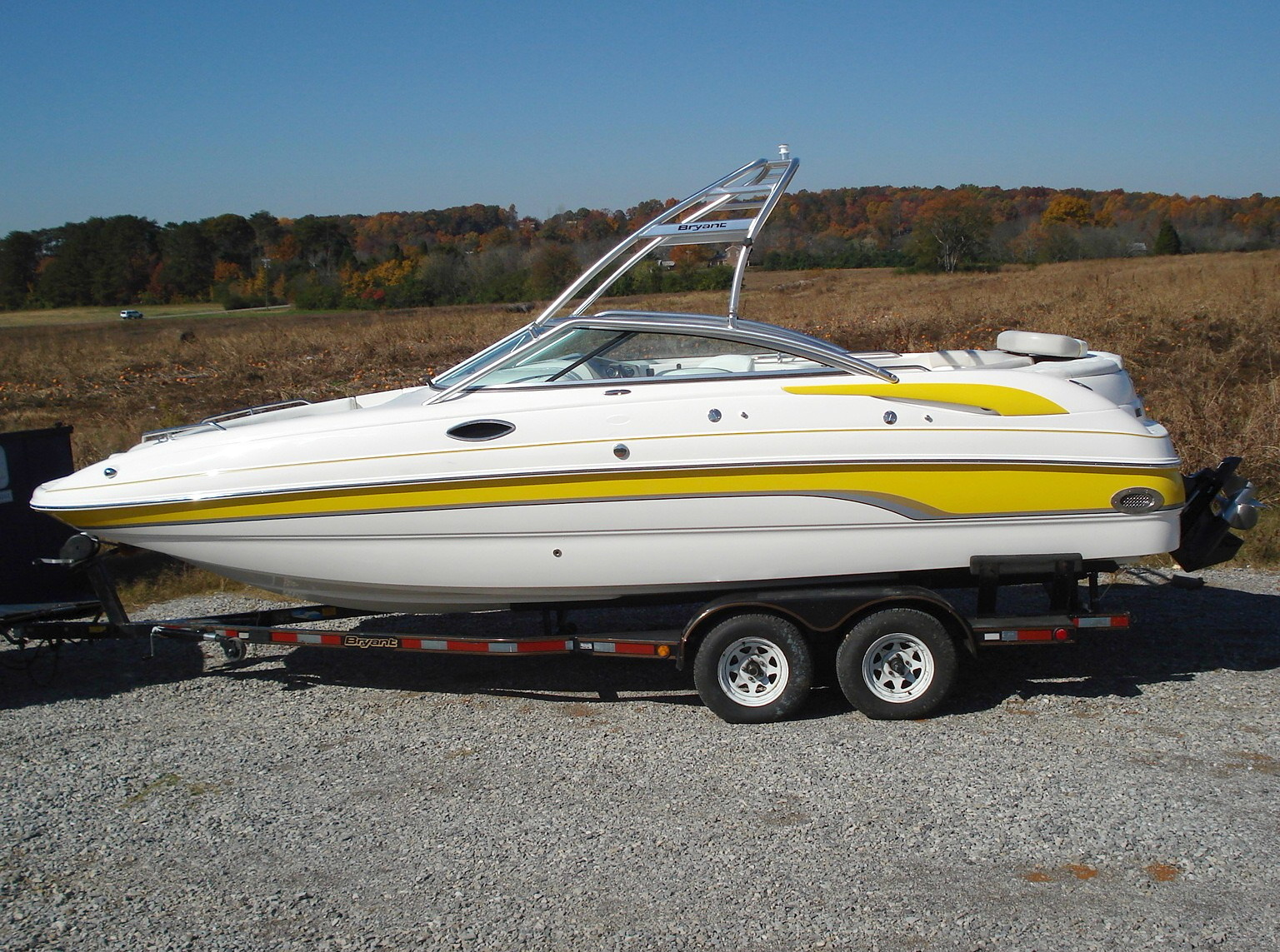 main image for 2006 bryant 236 wake boat with new diomension wakeboard tower