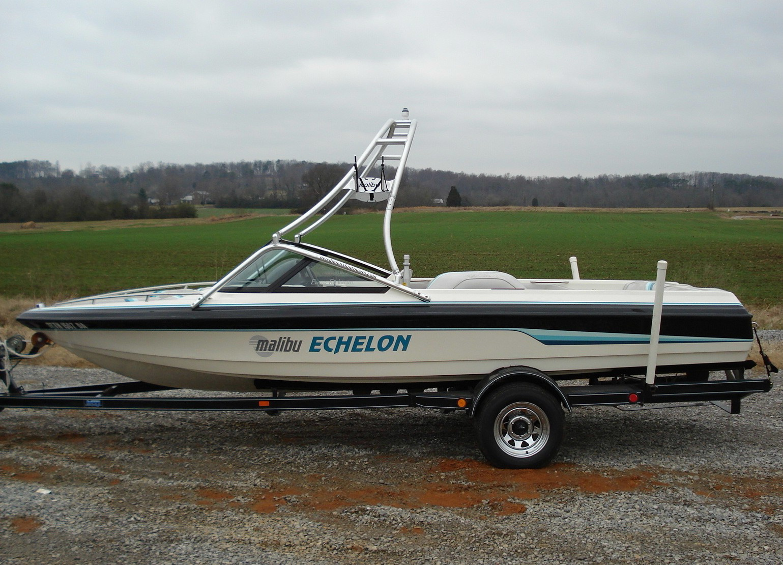 main view of 93 - 98 malibu echelon wakeboard boat with new dimension towers