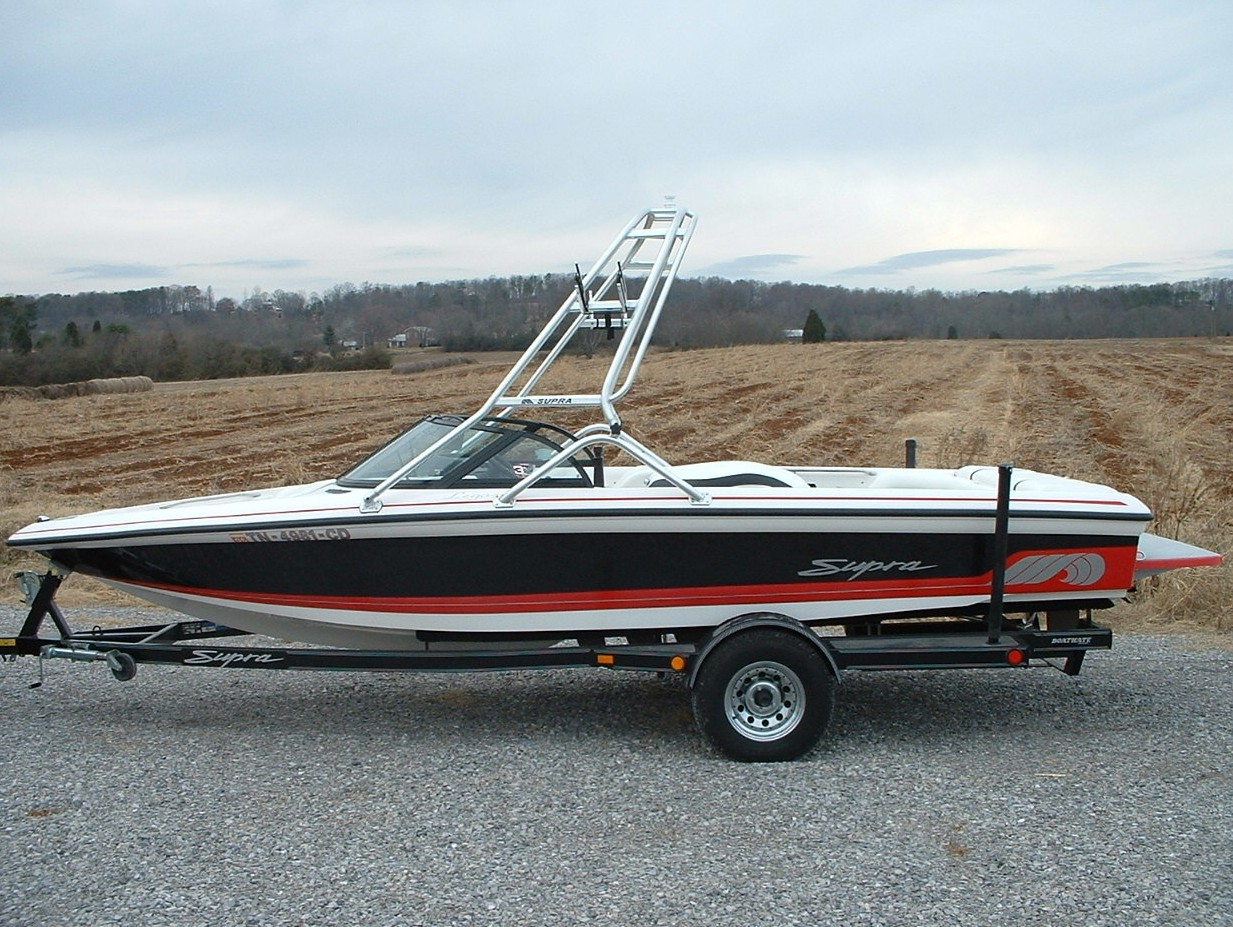 main image of 98 - 01 supra legacy boat with new dimension wakeboard tower