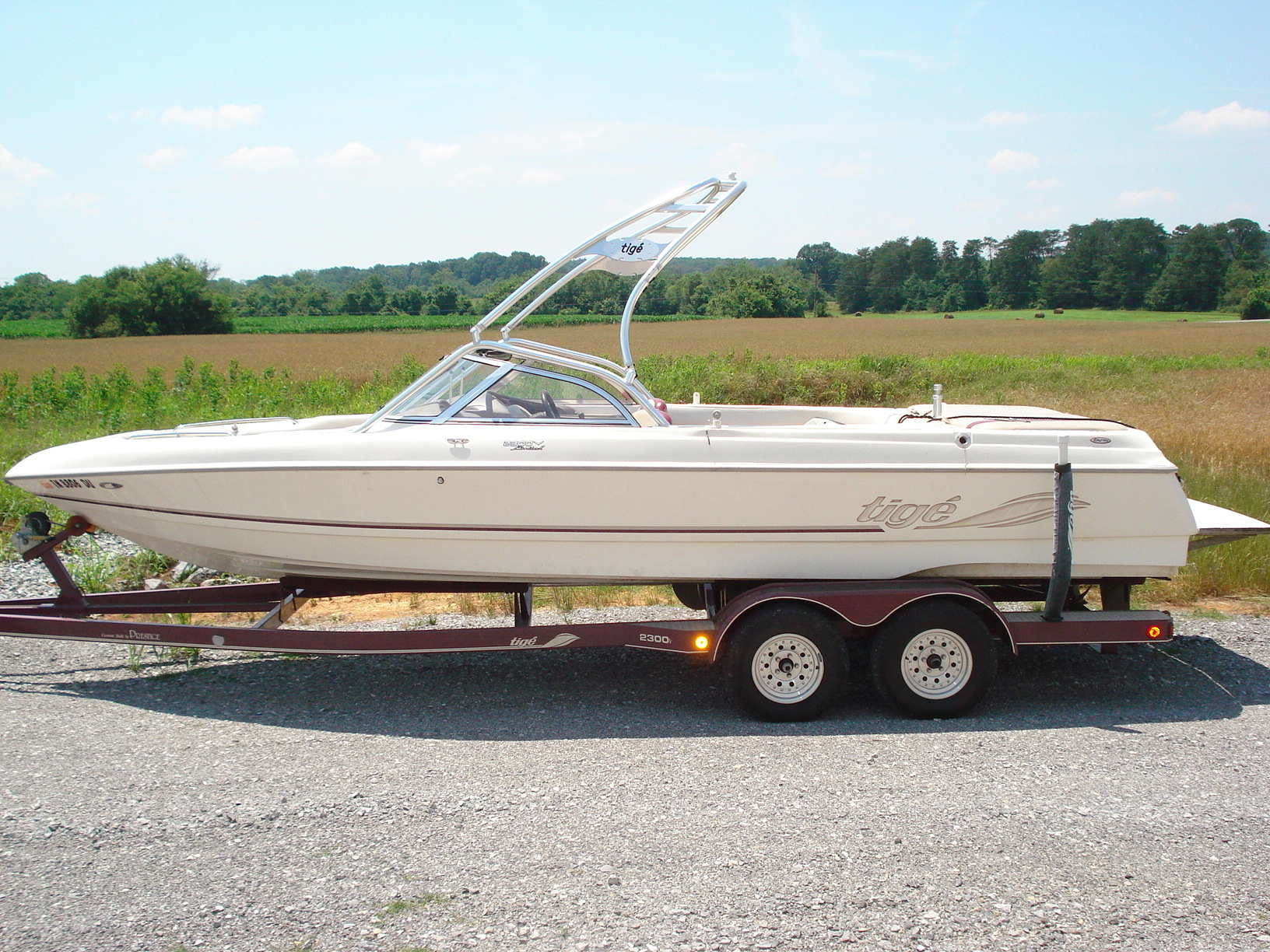 main view of 98 - 01 tige 2300V wake boat with new dimension tower