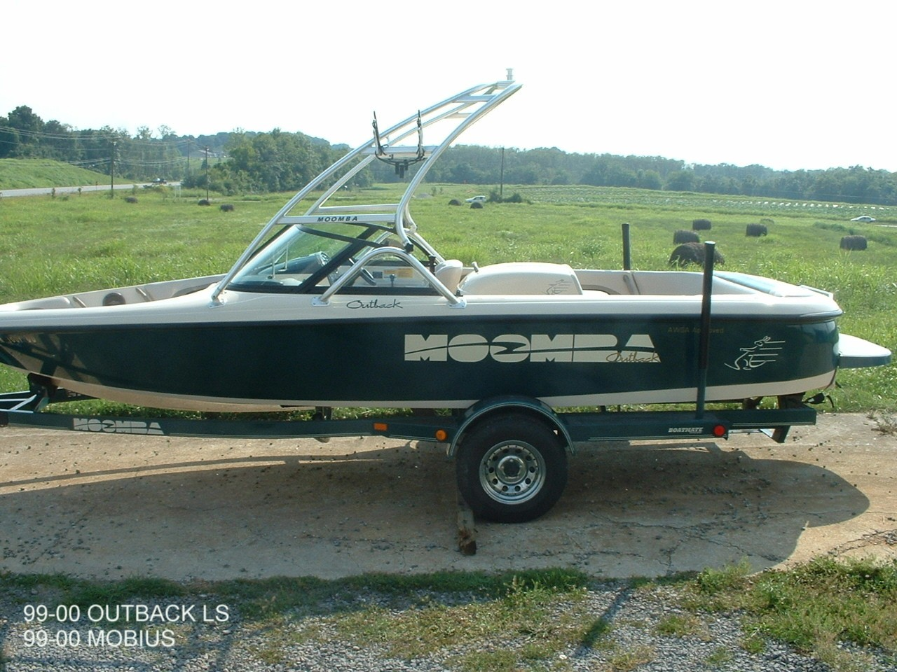 main view of 99 - 00 moomba outback ls with new dimension towers wakeboard tower