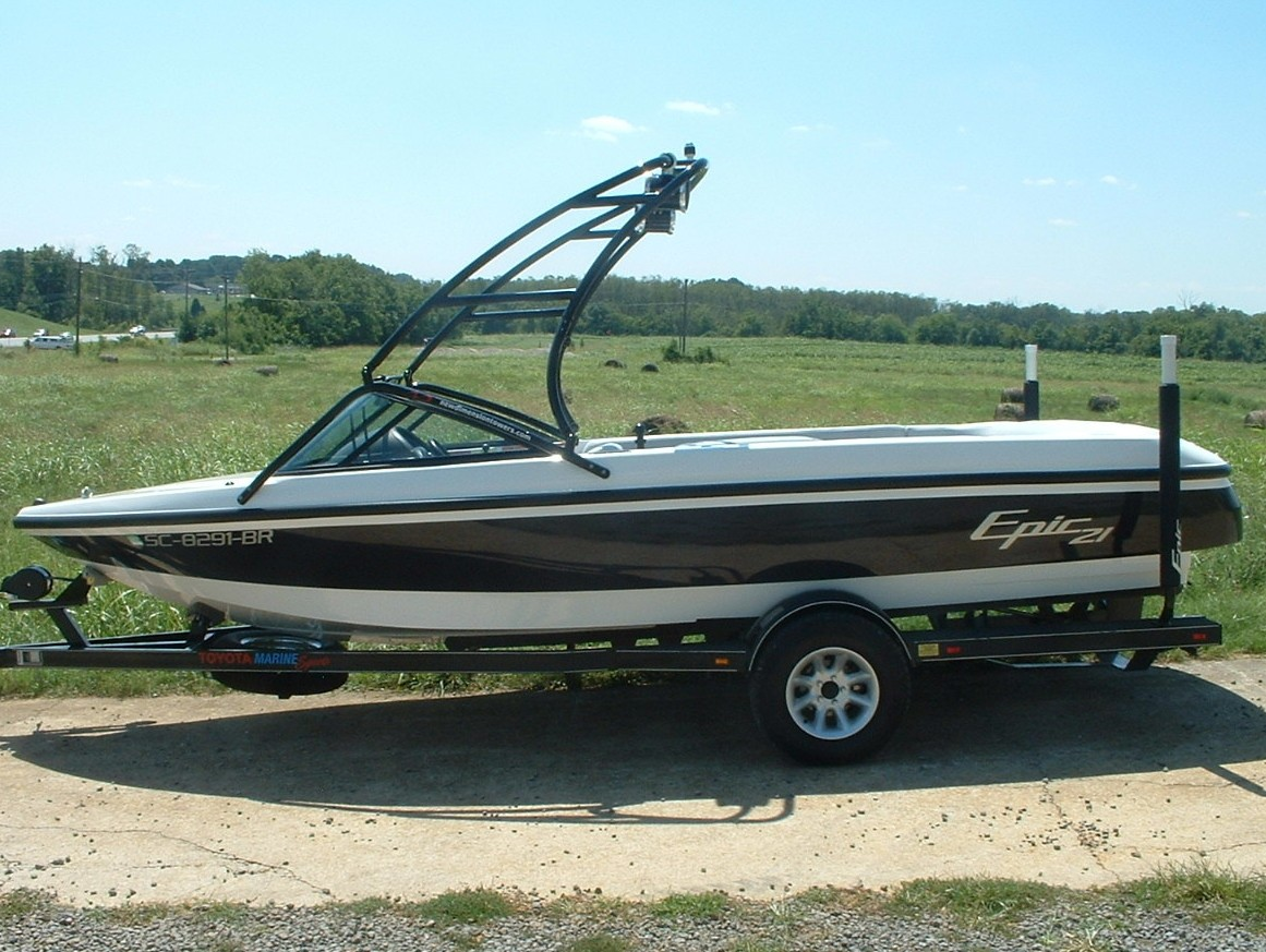 main image of 99 - 01 toyota epic 21 boat with new dimension wake board tower